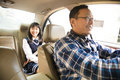 Father driving to school with teen daughter Royalty Free Stock Photo