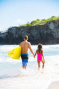 Father and Duagher on the Beach Going Surfing Royalty Free Stock Photo