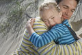 Father embracing daughter on beach closeup of loving Stock Photo