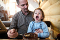 Father feeding his son with soup. Boy with mouth open. Royalty Free Stock Photo