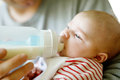 Father feeding newborn baby daughter with milk in nursing bottle Royalty Free Stock Photo