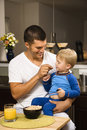 Father feeding son. Royalty Free Stock Photography