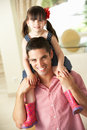 Father Giving Daughter Ride On Shoulders Indoors Royalty Free Stock Photography