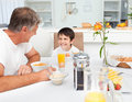 Father having his breakfast with his son Stock Images