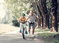 Father help his son learn to ride bicycle Royalty Free Stock Photo