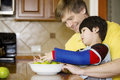 Father helping disabled son  in the kitchen Stock Photography