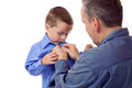 Father helping his son fastening his shirt buttons Stock Photo