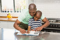 Father helping his son with homework Royalty Free Stock Photo