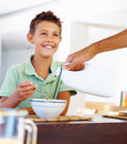 Father  helping son at breakfast Stock Photography