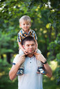 Father and his baby son having fun in the park outdoor happy Royalty Free Stock Image