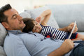 Father and his daughter enjoying free time with tablet Royalty Free Stock Photo