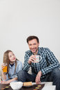 Father with his daughter having a brakfast man and girl breakfast Royalty Free Stock Photography