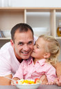 Father and his daughter having breakfast Stock Image