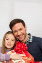 Father with his daughter smiling sitting together happy family celebrating christmas Stock Images