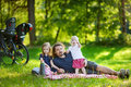 Father and his daughters picnicking in the park young Stock Photo