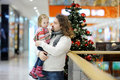 Father and his girl in shopping mall on Christmas Stock Images