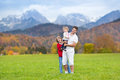Father with his kids in field in snow mountains Royalty Free Stock Photo