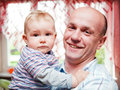 Father with his little baby son portrait in home happy smiling Royalty Free Stock Photo