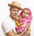 Father with his little child smiling happy young blond caucasian he is holding girl in arms the girl is after Royalty Free Stock Photo