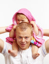 Father with his little child smiling happy young blond caucasian he is holding girl on shoulders the girl ia after Stock Photography