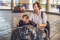 Father and his son having a ride in the bumper car at the amusement park Royalty Free Stock Photo