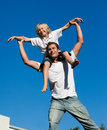 Father with his son on his back Stock Images