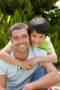 Father with his son hugging in the garden Royalty Free Stock Photography
