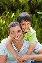 Father with his son hugging in the garden Stock Images