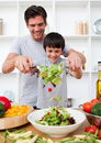 Father and his son preparing a salad Royalty Free Stock Image