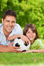Father and his son with their ball in the park Stock Photo