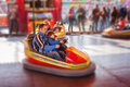Father and his two sons l having a ride in the bumper car at the amusement park Royalty Free Stock Images