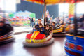 Father and his two sons l having a ride in the bumper car at the amusement park Royalty Free Stock Photo