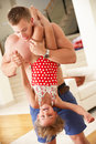 Father Holding Daughter Upside Down Royalty Free Stock Photos