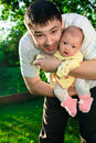 Father holding newborn joyful baby Royalty Free Stock Image