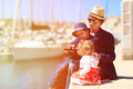 Father and kids looking at binoculars in the port two family travel Stock Images