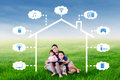 Father and kids sit under smart house design Royalty Free Stock Photo