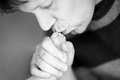Father kissing foot of newborn baby. Royalty Free Stock Photo