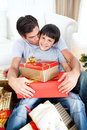 Father kissing his son after giving him a present Stock Image