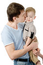 Father kissing his son. isolated on white backgrou Royalty Free Stock Photo