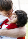 Father kissing his young son Royalty Free Stock Photo
