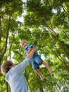 Father lifting son outdoors Royalty Free Stock Image