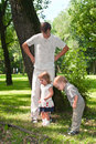 Father and little children in park playing Stock Photography