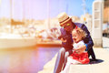 Father and little daughter looking at binoculars in the port family travel Stock Photo