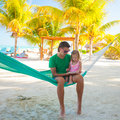 Father with little daughter on tropical vacation relaxing in hammock this image has attached release Royalty Free Stock Photography