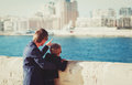 Father and little son travel in the city looking at modern buildings family Stock Image