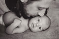 Father long hair kissing his son Royalty Free Stock Photo