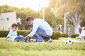 Father Looking After Son Injured Playing Football Royalty Free Stock Photo