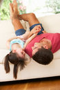 Father Lying Upside Down On Sofa With Daughter Royalty Free Stock Photo