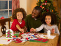Father making Christmas cards with children Royalty Free Stock Photos