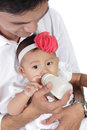 Father milking baby Royalty Free Stock Photo